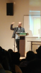 Junot Diaz at the podium during the VONA/Voices faculty reading